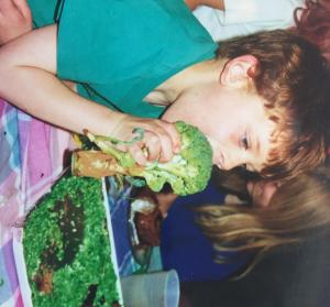 Owen choosing broccoli over chocolate cake as a little boy